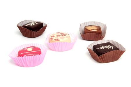 five delicious pink petit four over white background Stock Photo - 8675038