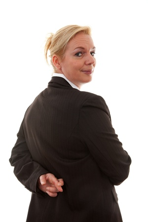 Liar businesswoman with crossed fingers at back over white background Stock Photo - 8791616