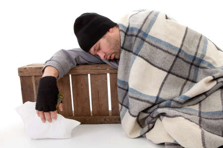 homeless beggar asleep over white background photo