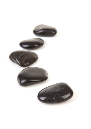 stepping: Black stepping stones in a row over white background