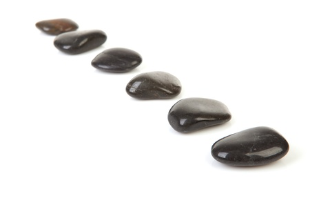 Black stepping stones in a row over white background Stock Photo - 8791661