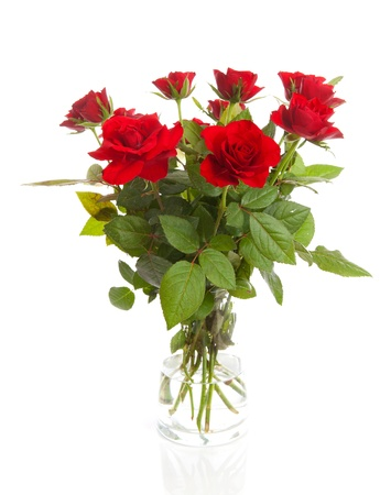 Bouquet of red roses in vase over white background
