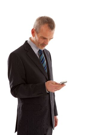 Older business man with smart phone over white background photo