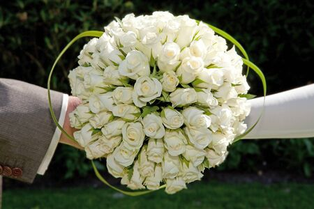 bride and groom holding wedding bouquet Stock Photo - 8792747