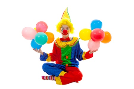 grime: child dressed as colorful funny clown with balloons over white background
