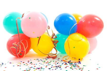 colorful balloons, party streamers and confetti over white background