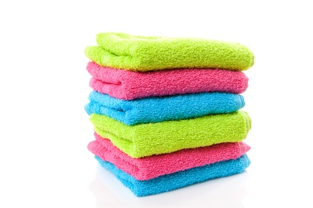 Pile of colorful towels over white background