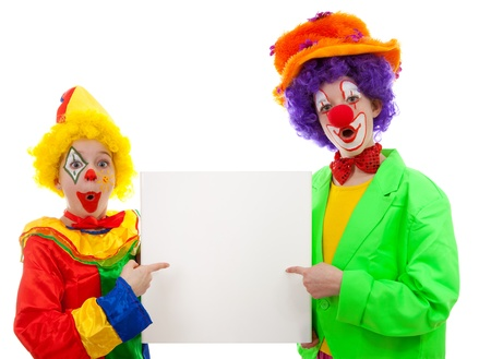 clowns: Two girl clowns holding empty text board over white background