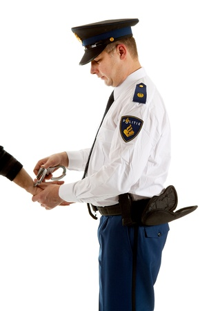 police man is making a arrest over white background photo