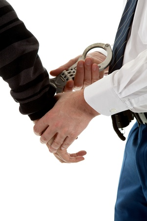 police agent is making a arrest in closeup over white background Stock Photo - 9092316