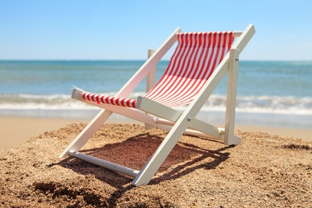 Beach chair near the ocean on sunny day