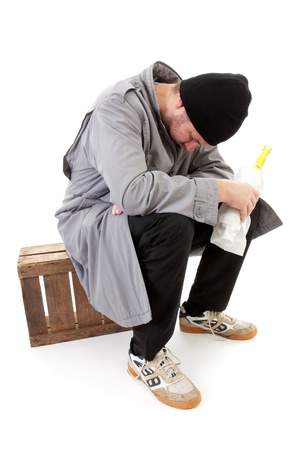 lonelyness: male homeless tramp with bottle over white background
