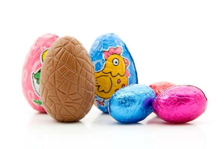 Colorful chocolate easter eggs, isolated on white background photo