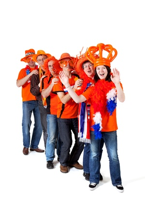 cheering fans: Group of orange Dutch soccer fans over white background