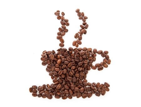 Coffee beans arranged into a shape of cup with steam over white background   photo