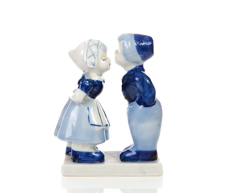 Typical Dutch souvenir in Delft blue over white background photo