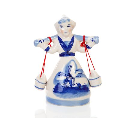 Typical Dutch statue of Delft blue milkmaid over white background photo