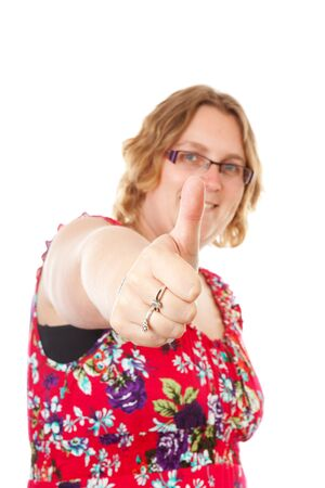 gratified: woman with thumbs up over white background   Stock Photo