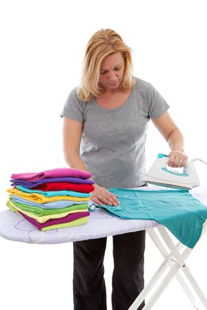 housewife is doing the ironing over white background photo