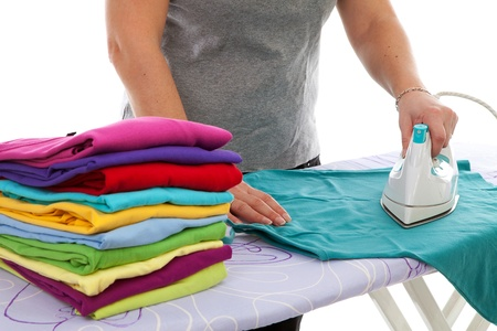 woman ironing: housewife is doing the ironing over white background