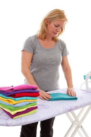 Housewife is folding clothes over white background photo