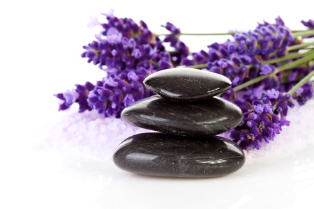 stepping stone: stacked black steping stones and lavender flowers over white background Stock Photo