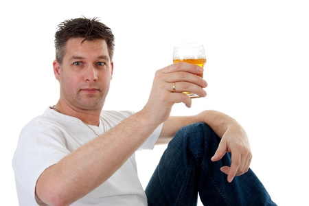 Cheers, man is toasting with glass of beer over white background Фото со стока