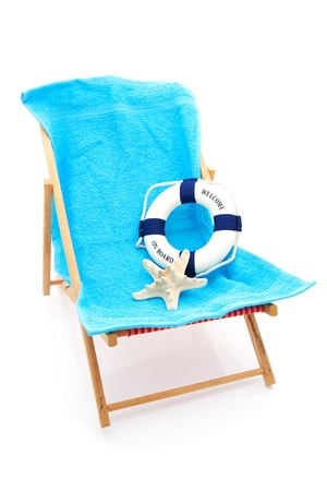 beach chair with blue towel and life buoy over white background