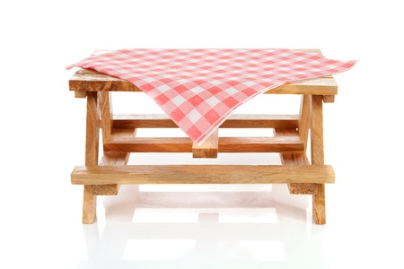on the tablecloth: empty picnic table with tablecloth over white background