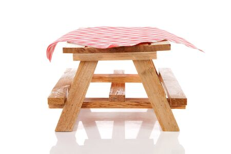 empty picnic table with tablecloth over white background photo