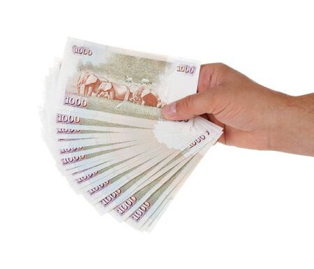 Hand holding Kenyan currency over white background Stock Photo - 10204644