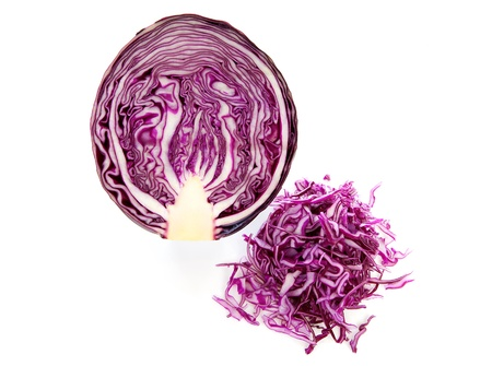 savoy cabbage: half and cut red cabbage over white background