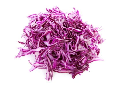 cabbages: pile of cut red cabbage over white background