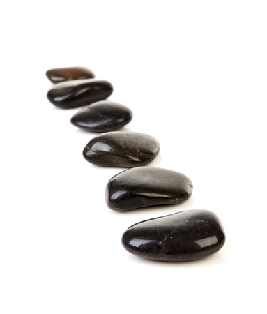 Black stepping stones in a row over white background Stock Photo - 10484938