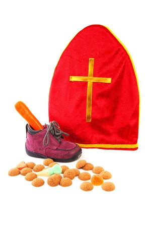 pepernoten: Mitre also know as mijter of Sinterklaas and pepernoten, part of typical Dutch tradition, isolated on white background   Stock Photo
