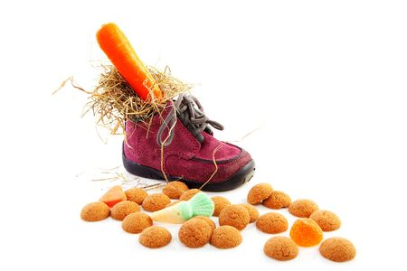 pepernoten: shoe and pepernoten, part of typical Dutch Sinterklaas tradition, isolated on white background
