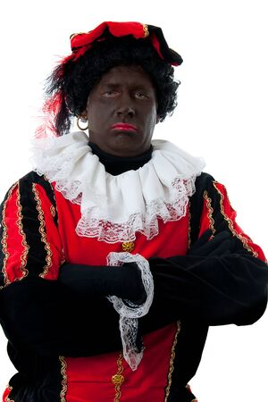 Zwarte piet ( black pete) typical Dutch character part of a traditional event celebrating the birthday of  Sinterklaas in december over white background with arms crossed Stock Photo - 10812915