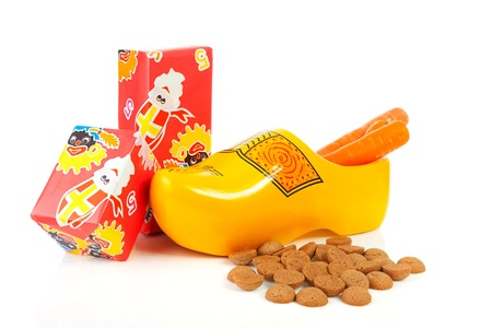 pepernoten: Dutch wooden shoe with presents and pepernoten over white background