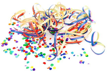 colorful confetti and party streamers over white background