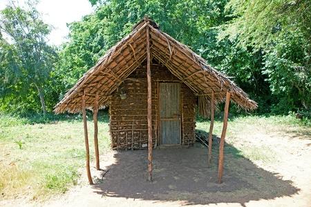 African hut house in village on island Funzi Kenya