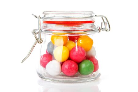 gumballs: pot with colorful gumballs over white background
