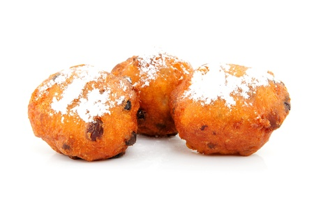 Three Dutch donut also known as oliebollen, traditional New Years eve food isolated on white background
