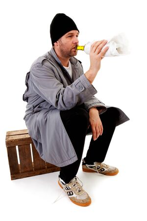 tramp: male homeless tramp with empty bottle over white background