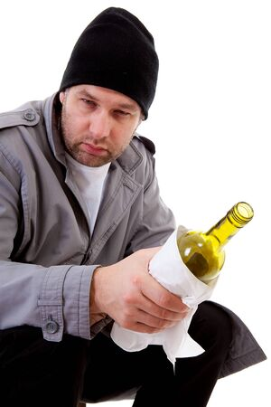 lonelyness: male homeless tramp with empty bottle over white background