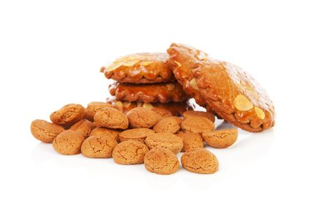 sinterklaas: Pile of typical Dutch filled gingerbread cookies over white background