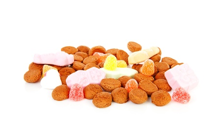 strooigoed: typical Dutch sweets: pepernoten (ginger nuts) for a celebration at 5 december in the Netherlands over white background  Stock Photo