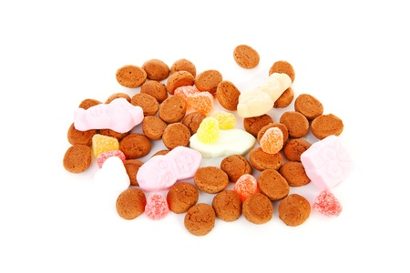 strooigoed: typical Dutch sweets: pepernoten (ginger nuts) for a celebration at 5 december in the Netherlands over white background