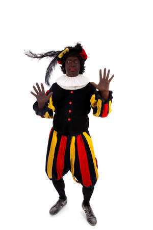 black pete: Zwarte piet ( black pete) typical Dutch character part of a traditional event celebrating the birthday of Sinterklaas in december over white background  Stock Photo