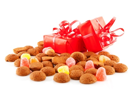 ginger nuts: Typical dutch sweets: pepernoten (ginger nuts) and presents for celebration at 5 december in the Netherlands over white background
