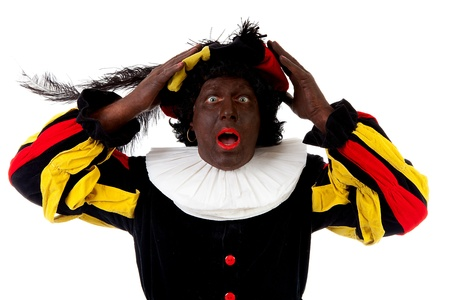 zwarte: Zwarte piet ( black pete) typical Dutch character part of a traditional event celebrating the birthday of Sinterklaas in december over white background